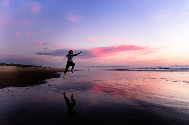 Jumping on the beach, Santa Cruz, California